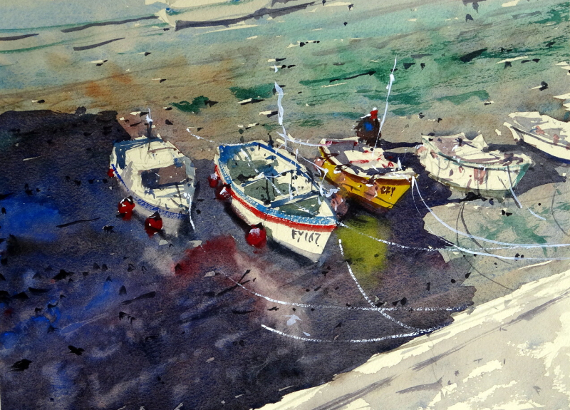Harbourside_view_down_to_5_boats_at_low_tide_porthleven