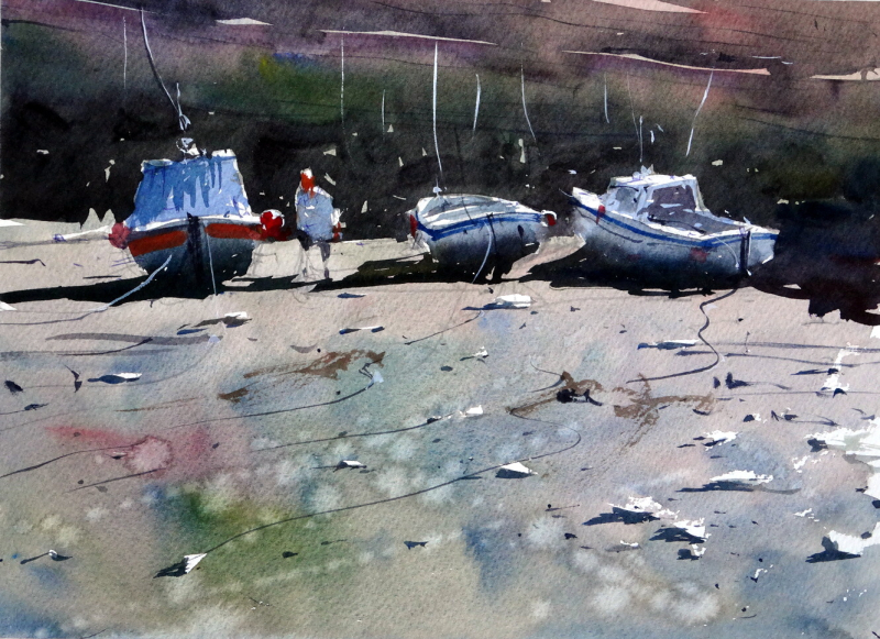 Three boats at low tide and fisherman